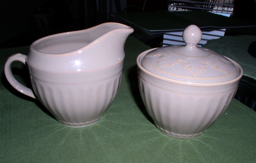 Creamer and Sugar set. A beautiful taupe color.