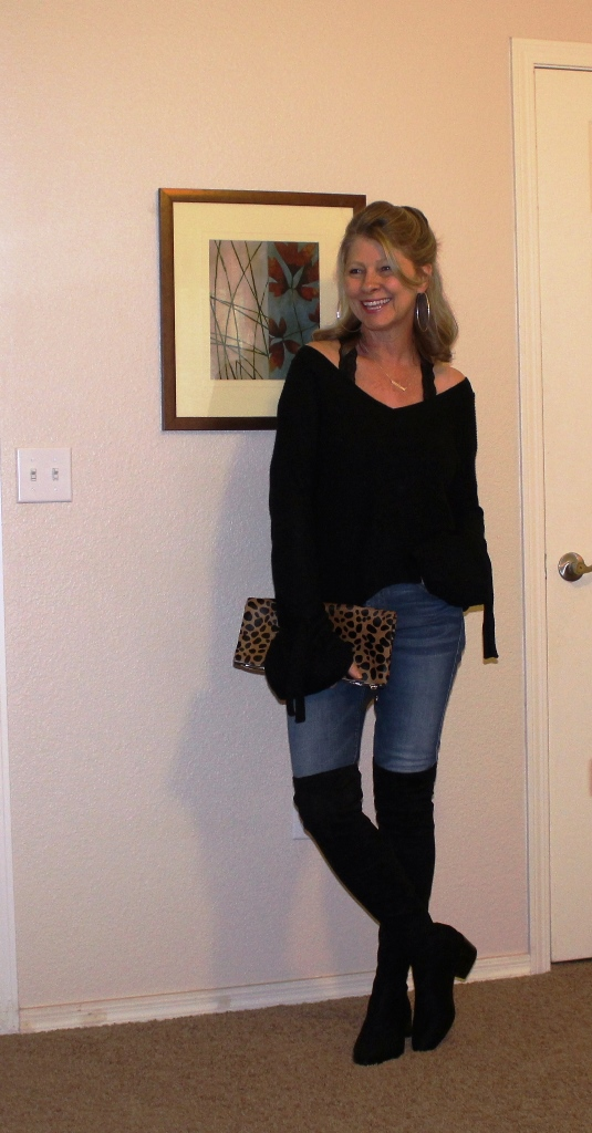 Almost Didn't Happen - Same boots, sweater (Comes in four colors, I have black and white because I am crazy about it. I sized up to medium for over sized fit and because it is a shorter sweater) and jeans all on sale and same clutch linked below.