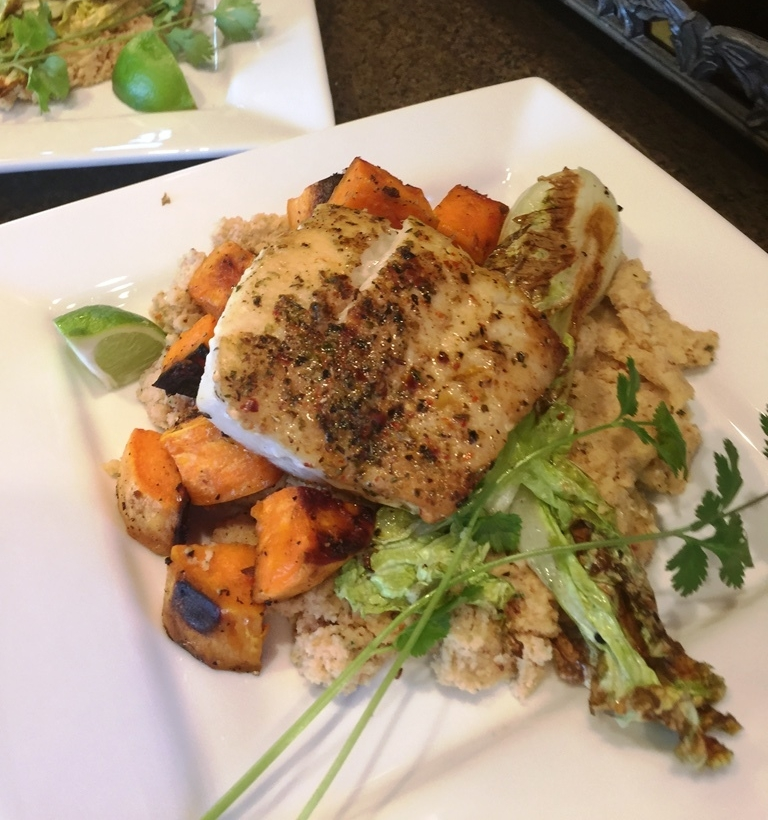 Baked Cod on a bed of - roasted-garlic, sun-dried tomato mashed cauliflower with roasted yams and napa cabbage.