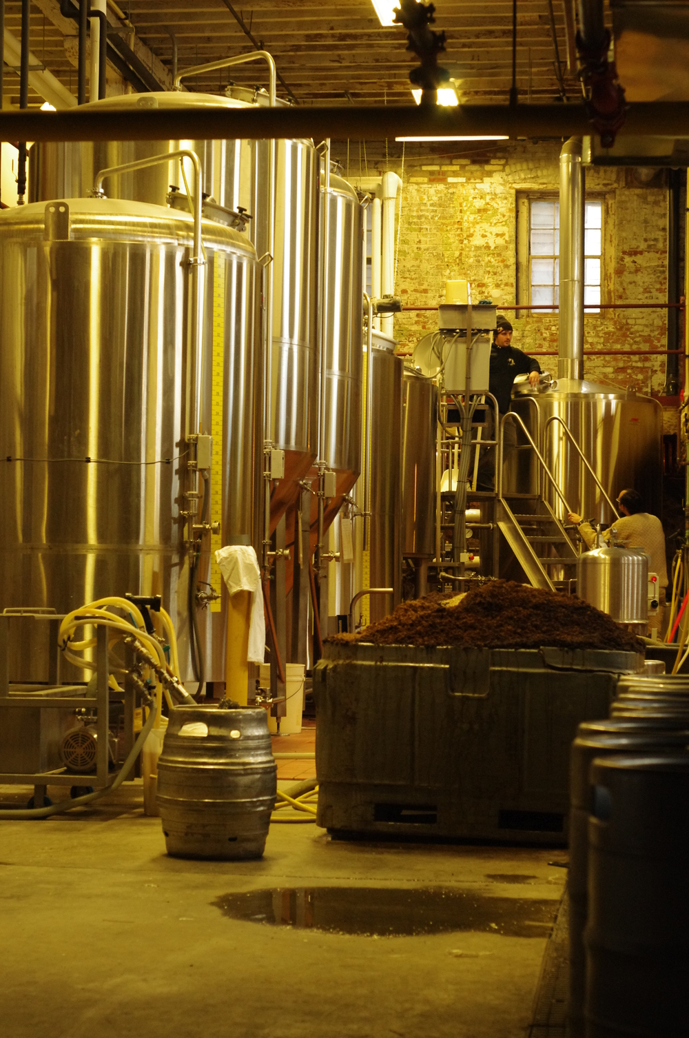 The brewhouse sits directly below the taproom in the restored building