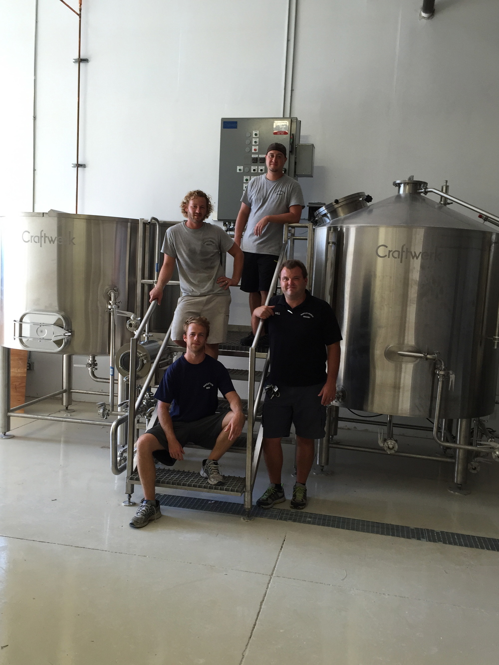 Will Lawson (on right) with the brewing team at Naples Beach Brewing