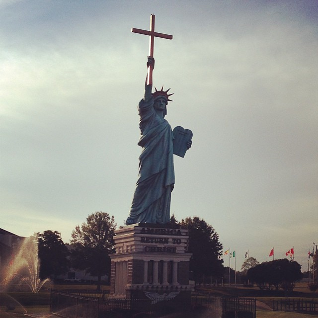 'Merica. On the corner of Kirby and Winchester, stands replica liberty with cross in hand…. A landmark I will drive past 2 ~ 4 times a day while on assignment. #memphismemos