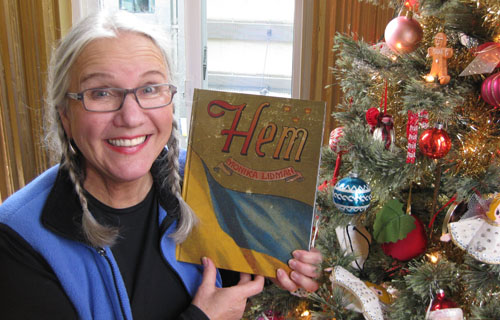 Monika holds the first copy of her book  Hem .