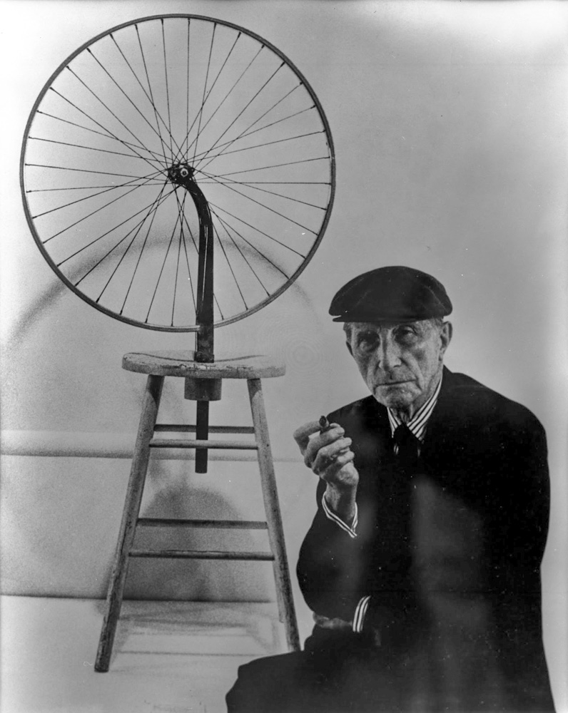 Marcel Duchamp next to  Bicycle Wheel , 1963.