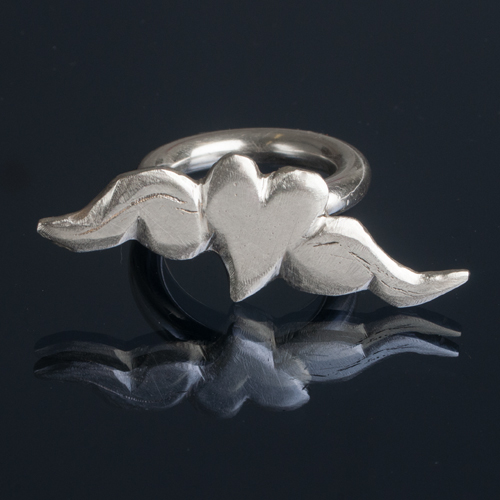 Silver heart and wings ring
