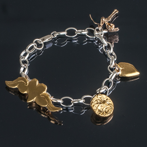 Charm bracelet with gold and silver charms