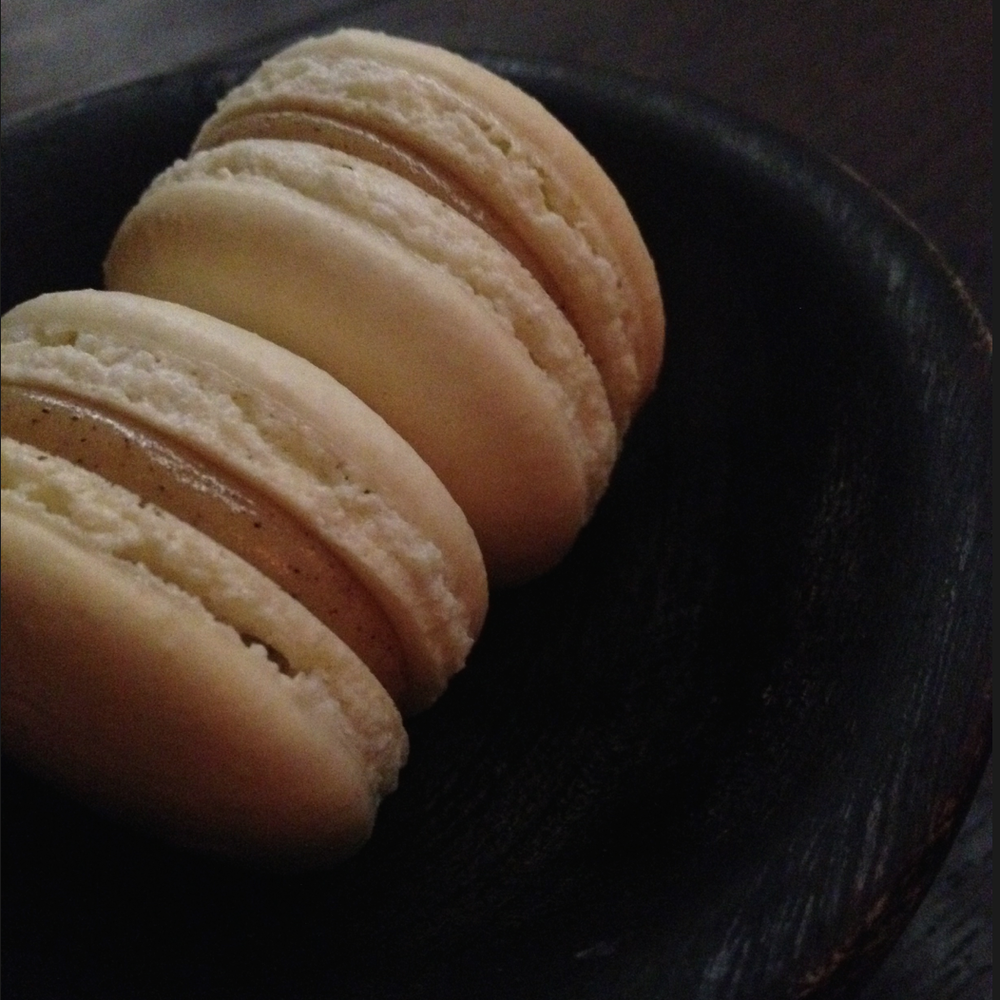 Delectable lemon verbena and brown butter macarons finish the meal at the Catbird Seat