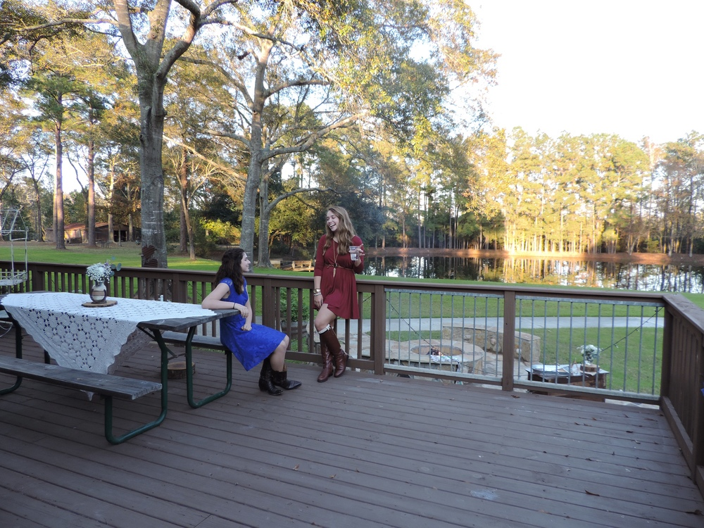 A couple of beautiful young ladies enjoying a conversation, as well as the stunning surroundings from our spacious deck.