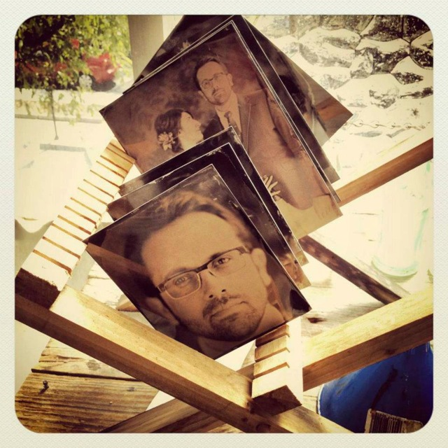 A sneak peek at our tintypes on a drying rack, shortly after developing...