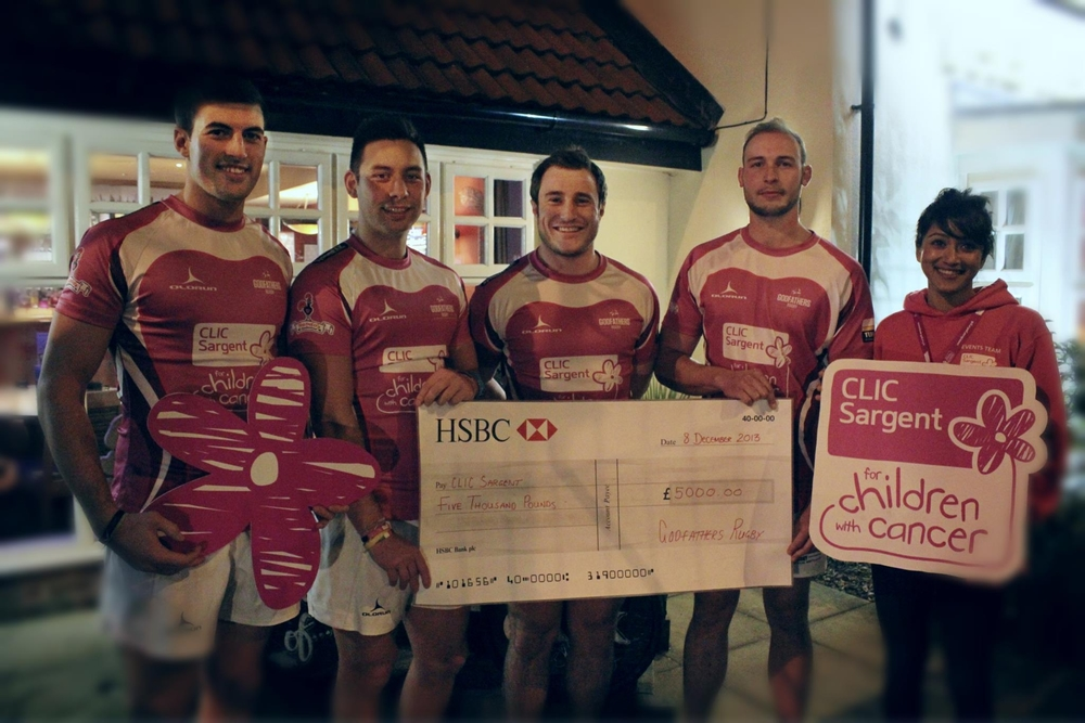 Senior Godfather players Cam Brown, Will Luangrath, Ryan Surry, and Ash Chalk along with Kiren Fernandes of CLIC Sargent outside the Red Admiral in Trowbridge