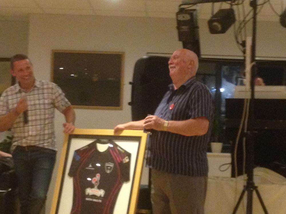 Don Senior receives a framed Godfathers shirt from Don Junior at his 70th birthday bash at Trowbridge RFC
