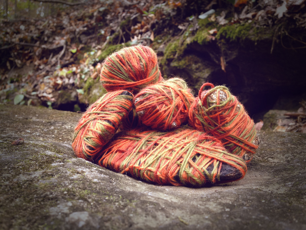 Stones wrapped in yarn on boulder. Athens, GA. Fall 2013. Instagram Filtered.