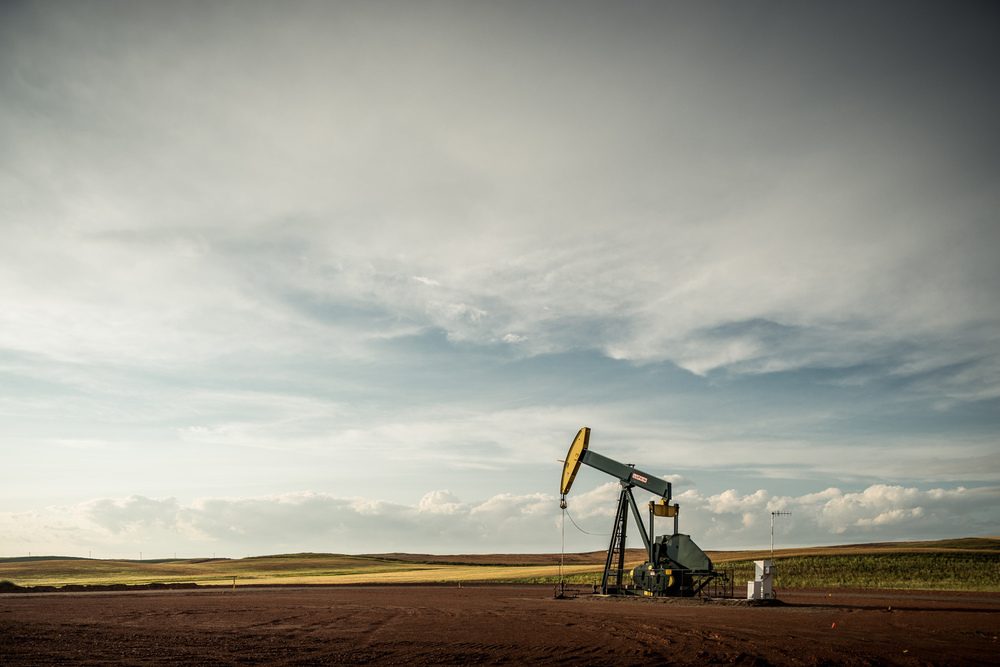 A Hess oil pump jack overlooks the North Dakota oil fields known as the Bakken in the aftermath of a thunderstorm.