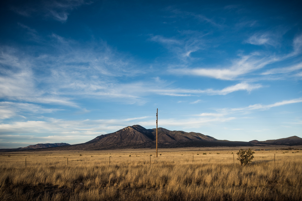 The Sierra Blanca peak overlooks the Tularosa Valley of New Mexico. In this valley, generations of my ancestors settled, were born, lived their lives and lie buried.