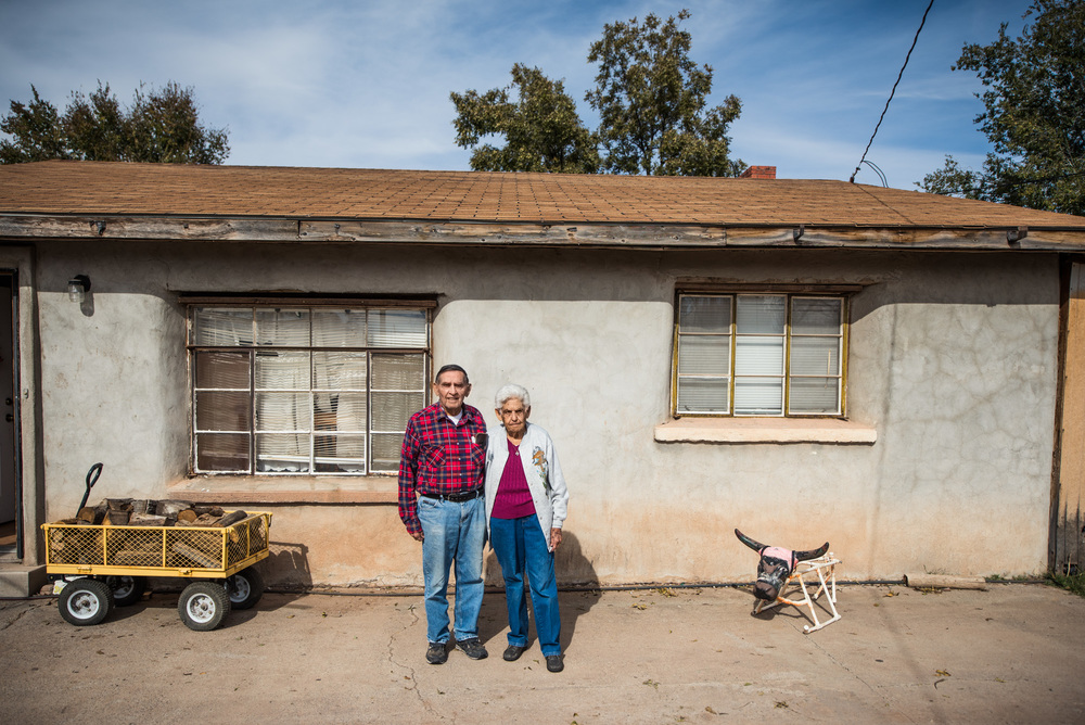 Fructoso Marujo, a distant cousin, and his wife outside the adobe home in Tularosa that he built back in the 1950's. Currently their children and their grand children live with them in the upgraded and modern baked-clay residence.