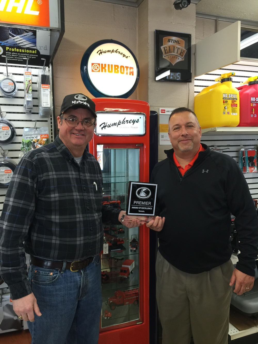 Brian Humphreys (Owner) of Humphreys' Outdoor Power Receives the Premier Award of Excellence from John Brookbank of Kubota
