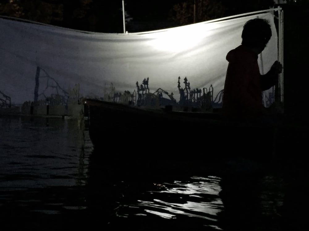 silhouette of participant kayaking and installation