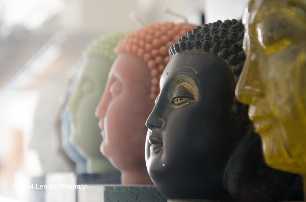 Photos of the day:  Excutive director of Capitol Arts Network, Judith HeartSong's studio/office space is flooded with natural light. The pattern and color scheme of her Buddha heads capture the ambient light beautifully.