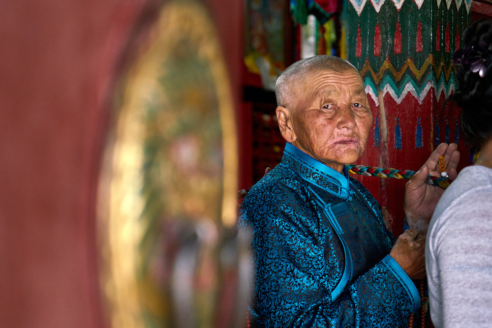 Khasar_S_GrandmaAtBuddhistCeremony_ErdeneZuu_UvurKhangai_Mongolia_Summer_2016.jpg