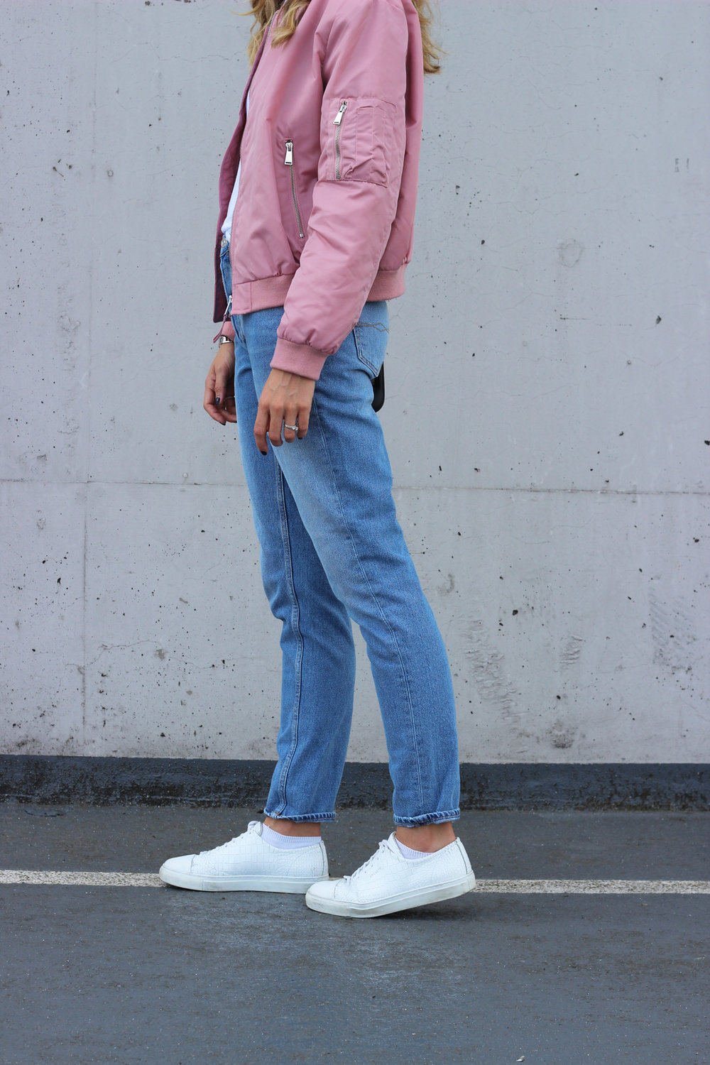 Zara pink quilted bomber (similar) / Zara white basic tee (similar) / Zara blue 'Mom jeans' (similar) / Axel Arigato Cayman cap-toe sneakers (similar) / Proenza Schouler PS11 Tiny bag