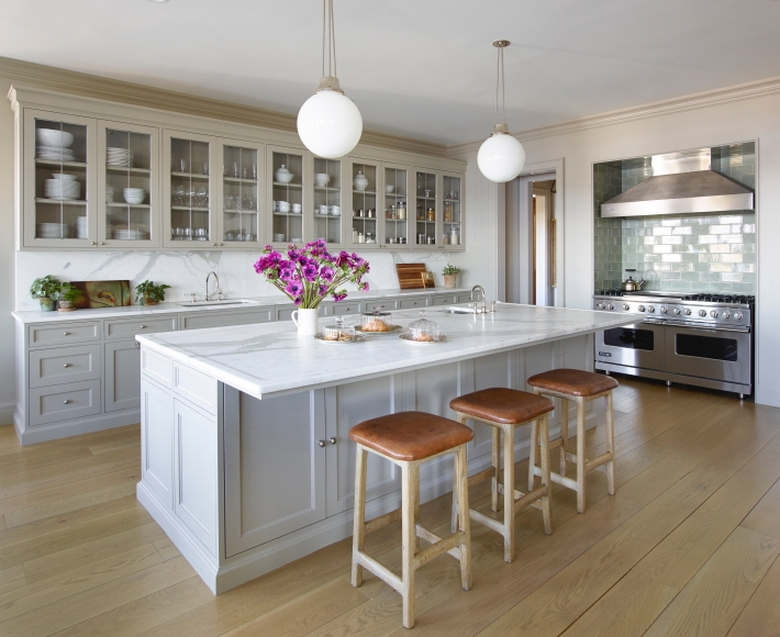 gray painted cabinets and backless barstools