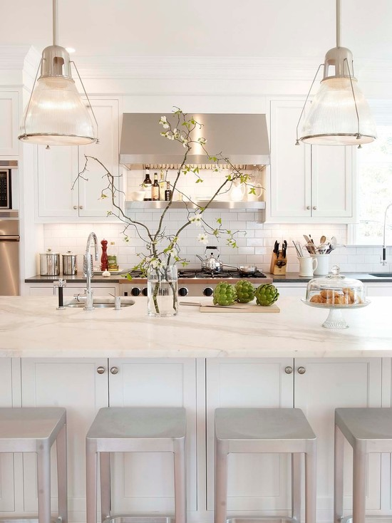 white kitchen with backless barstools