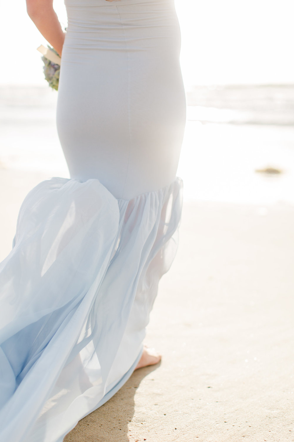 maternity photoshoot on the beach