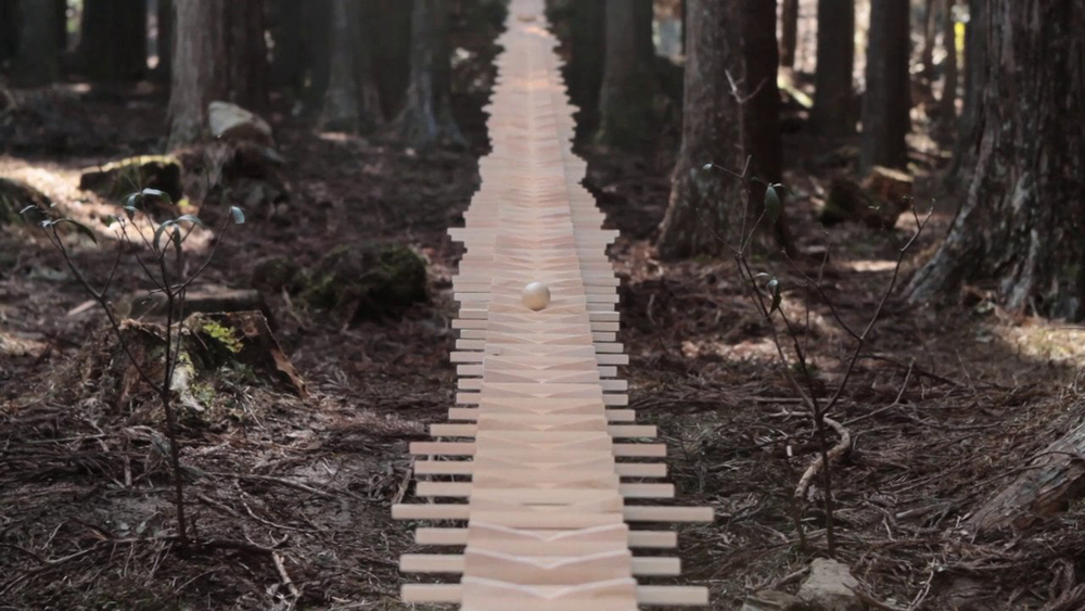 "A gigantic 44m xylophone made with surplus wood of trees. A promotional movie for ""Touch Wood SH-08C"", a mobile phone also made out of surplus wood."