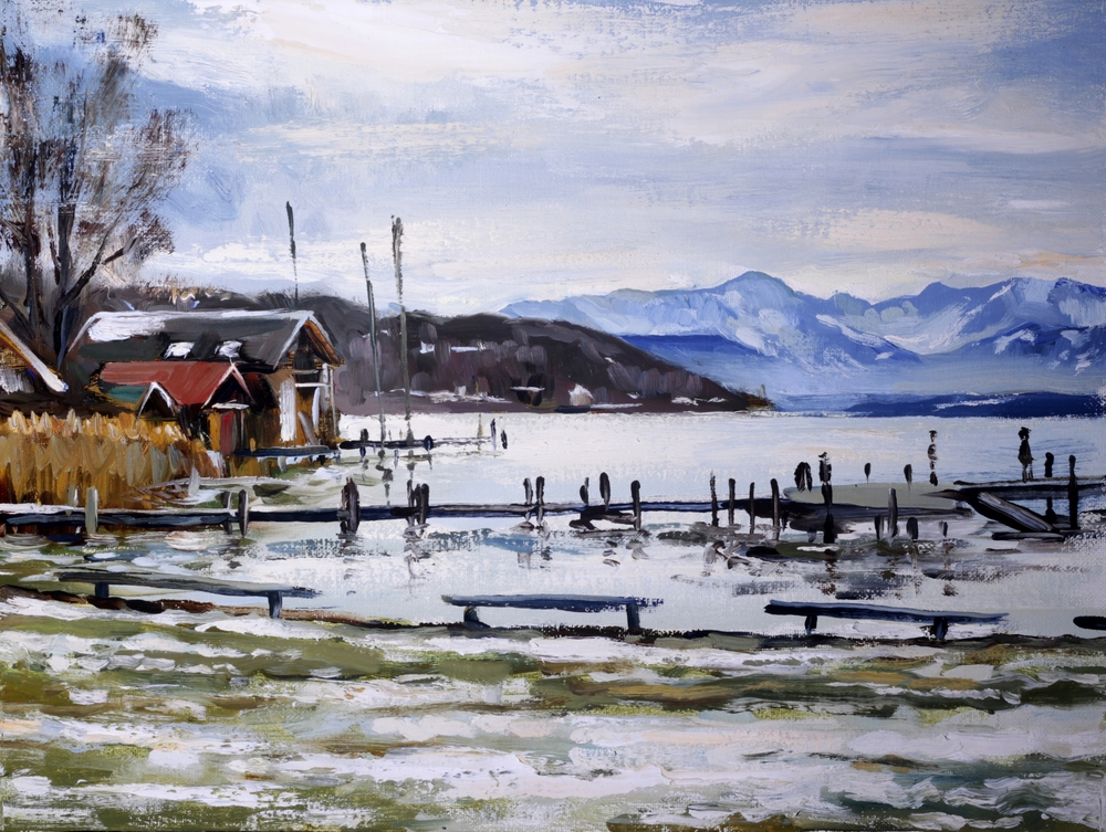 A view towards south to the Alps at the shore of the lake Starnberg at the end of winter.