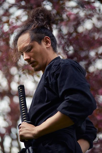 man-samurai-sword-kimono-cherry-blossoms-look-down.jpg