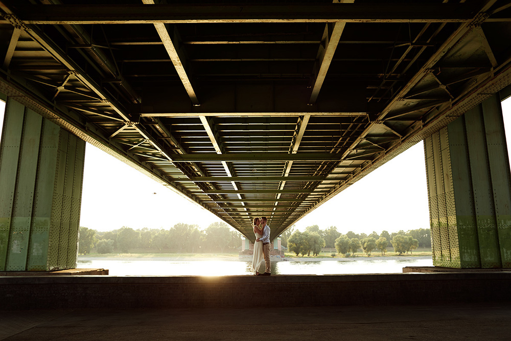 couple-engagement-wedding-dress-under-bridge.jpg