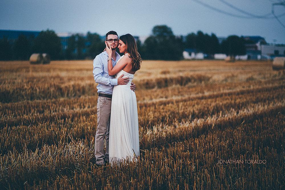 sarah-timwedding-couple-field-sunset-dress-embrace.jpg