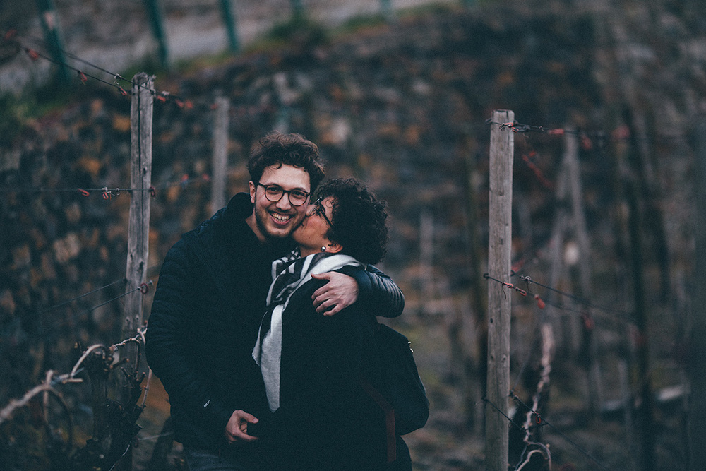 paddy-kadir-love-couple-kiss-cheek-wine-mountain.jpg
