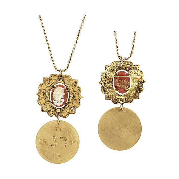 "Sterling silver chain with antique cameo pin and brass disc lightly plated in 24K gold, pin engraved ""Protection Against Evil Eye,"" disc engraved with kabbalistic astrological sign ""Scorpio"""