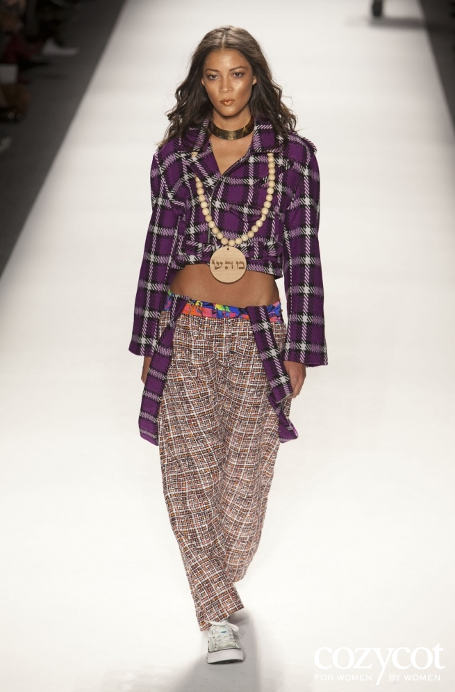 February 9, 2012: Mercedes Benz fashion week, wooden medallion Healing on wooden beads