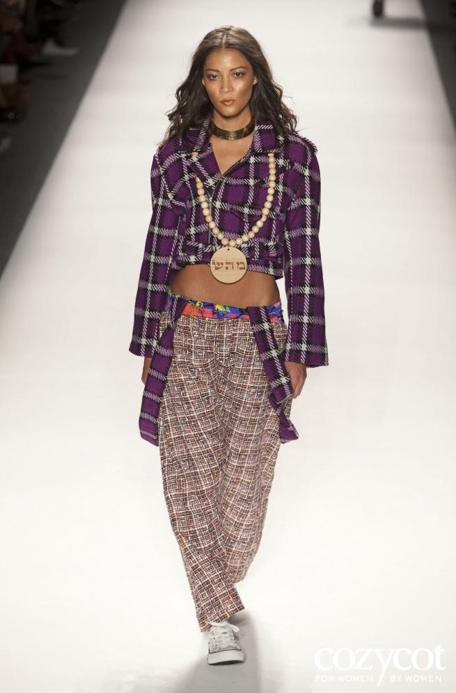 February 9, 2012: Mercedes Benz fashion week, wooden medallion Healing on wooden beads