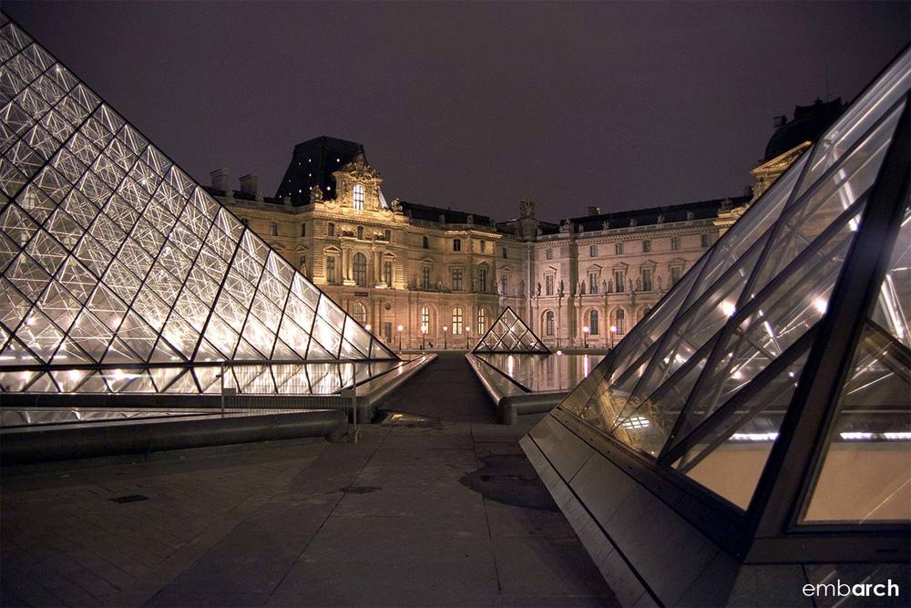 Louvre - exterior courtyard pyramids at night