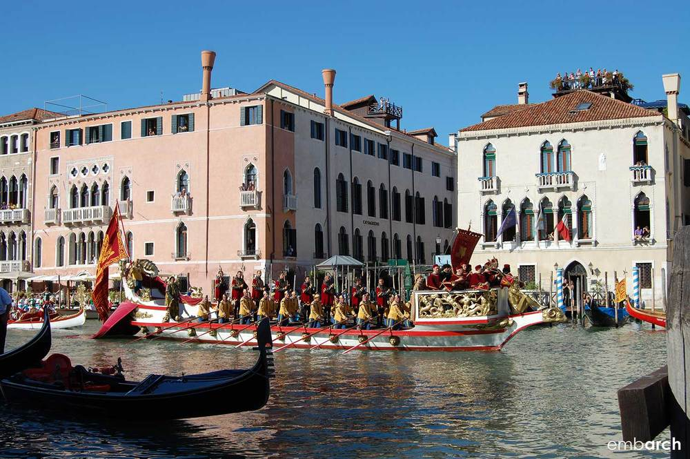 Colorful boats on the Grand Canal during the Regata Storica di Venezia.
