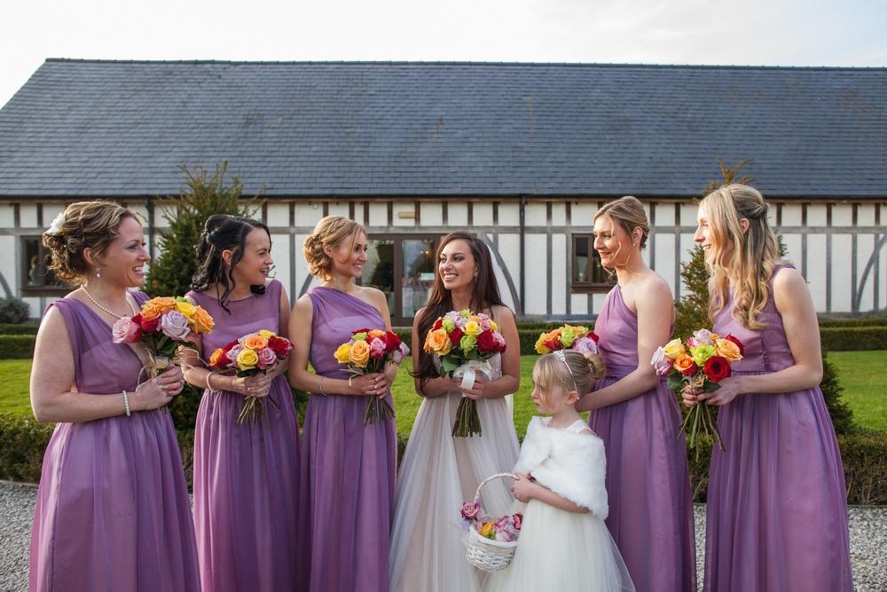 The Bride wears dress by Watters, Bridesmaids & Flower Girl wear Jessica Bennett Bepsoke Bride