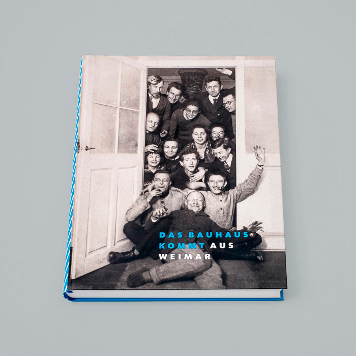 Das Bauhaus kommt book with a silly photo of Bauhaus members all piled up in a doorway smiling