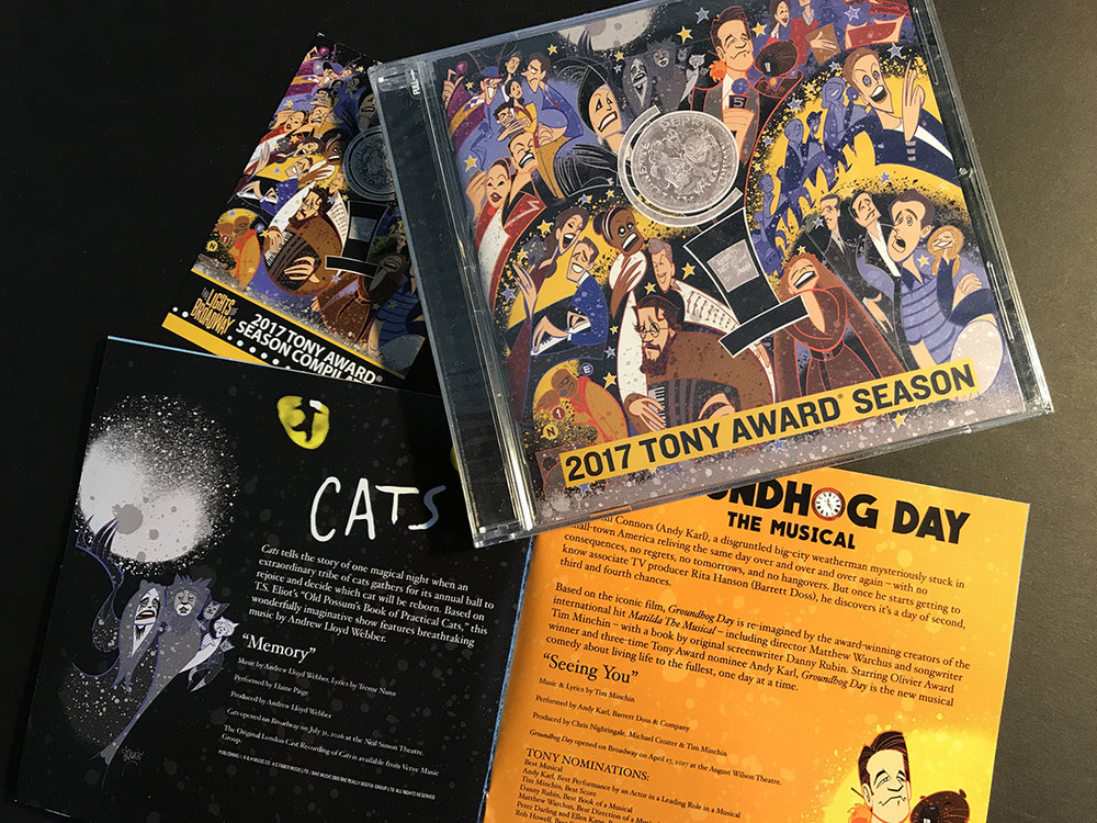 The CD, booklet, and limited edition trading card.