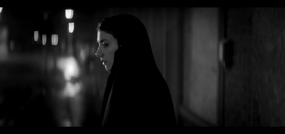 ANAMORPHIC STILL IMAGE WITH BOKEH CLIPPING FROM THE FILM: A GIRL WALKS HOME ALONE AT NIGHT (2014). (c) Pretty Pictures
