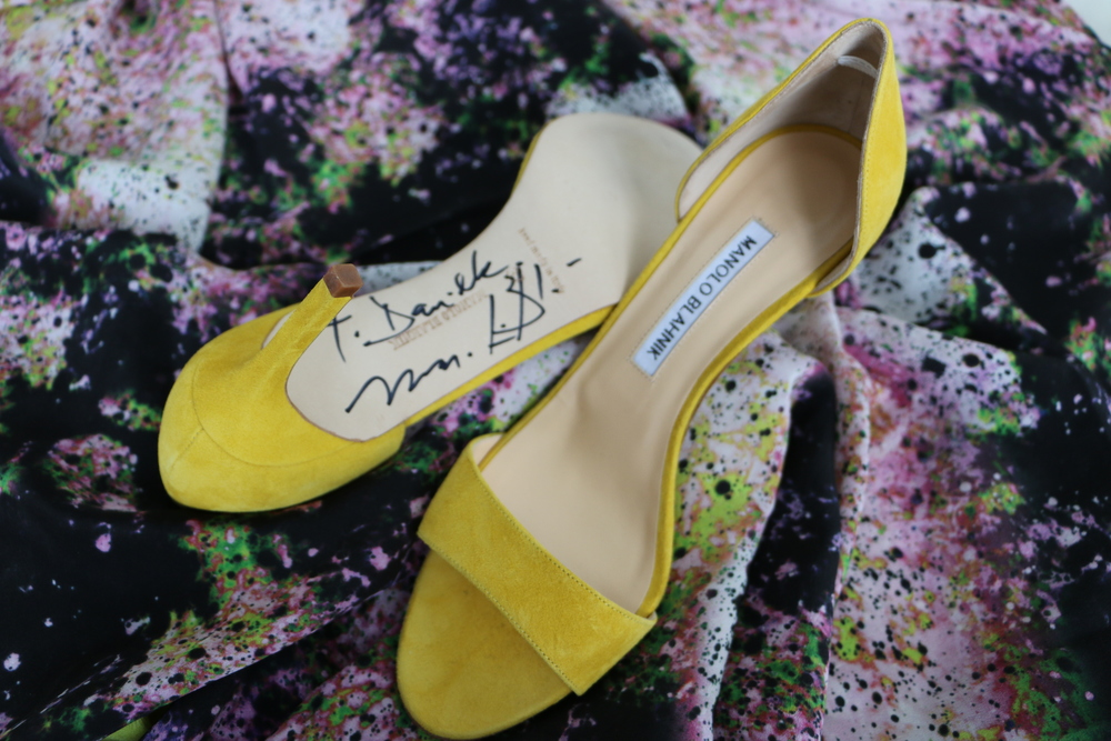 Manolo Blahnik made an appearance at Barneys in Chicago.  I got a chance to meet this iconic designer and have him make this pair of canary heels mine with his autograph.