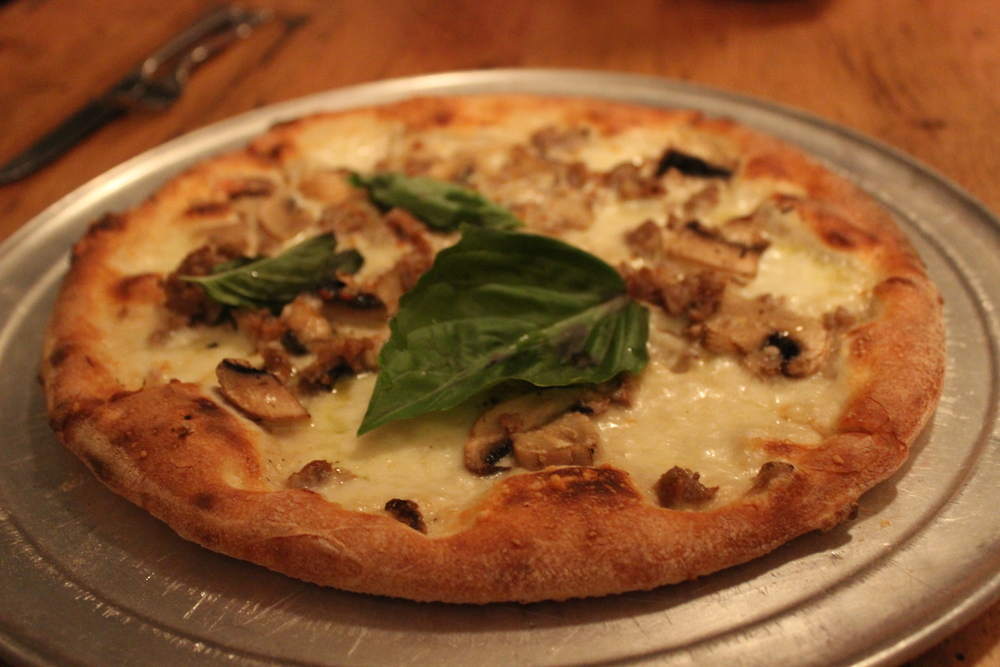 Boscaiola Pizza - topped with mozzarella, sausage, mushrooms and basil!