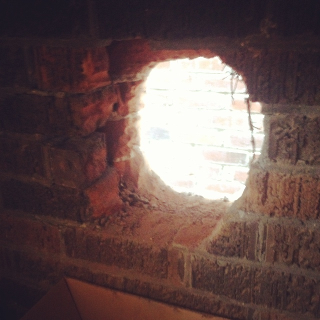 It took a while to drill this large hole through the double brick wall of our 96 year old house!