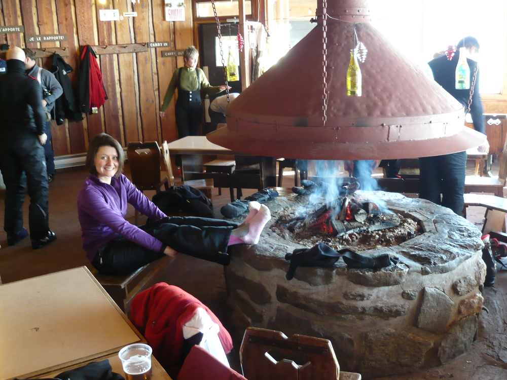 Warming my frosty feet at the top of the ski hill by one awesome open fire at Sutton Quebec