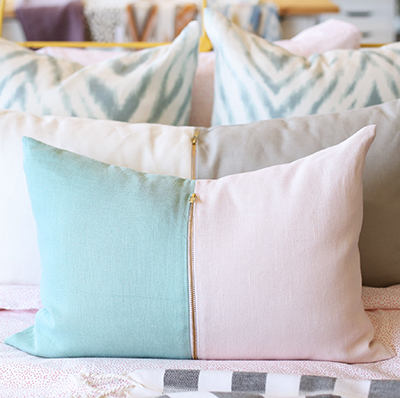 I love this creative Pillow by Tonic Living with brass zipper!!