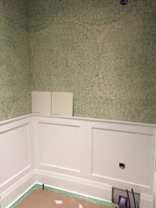 PROGRESS: By simply re-jigging the plumbing & adding simple white wainscoting, the space already seemed bigger & brighter. The bold floral wallpaper gave this Powder Room just the right amount of punch it needed.