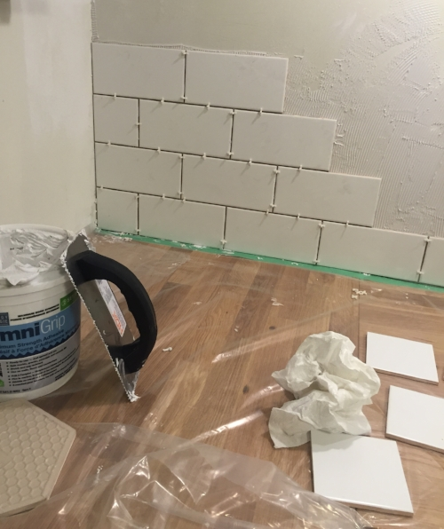 "We went back & forth on the backsplash material. Originally I chose a cool, very affordable peel & stick option from The Home Depot. However, it just seemed too flimsy for the space. So I opted for a large-scale 4""x8"" classic subway tile from Olympia Tile. I know that I will never grow tired of this timeless pattern!"