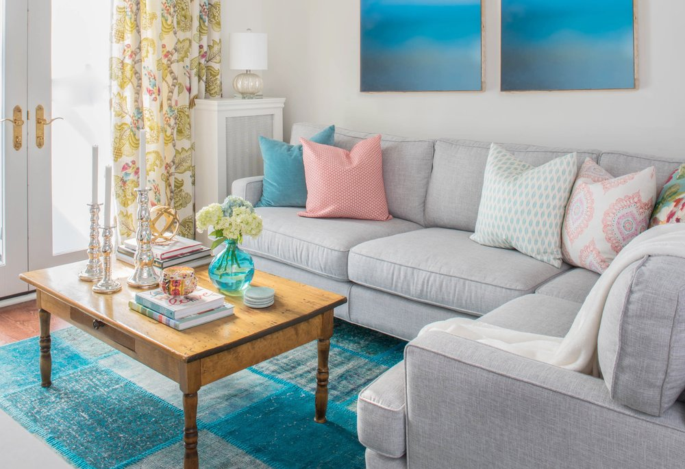 Use colour in accent cushions, rugs and drapery. These are easy to switch out over time.